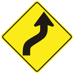 montana right and left curves road sign